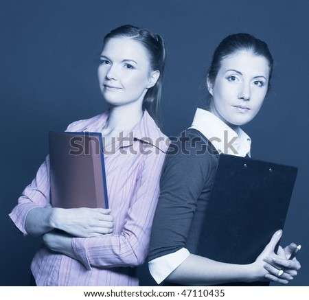 Managers. Two young women with folders.