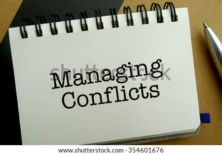 Managing conflict memo written on a notebook with pen