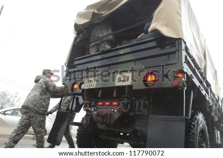 MANAHAWKIN,NJ-OCTOBER 29: The New Jersey National Guard evacuating residents and thier pets from Long Beach Island, NJ before Hurricane Sandy makes landfall.Oct 29 2012, Long Beach Island, NJ - stock photo
