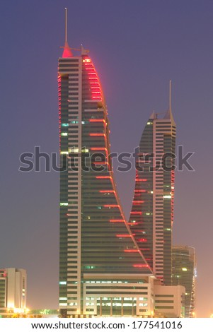 MANAMA, BAHRAIN - AUGUST 22, 2008: Bahrain Financial Harbor at night. The building is a world-class, fully integrated waterfront development and important architectural icon in the city. - stock photo