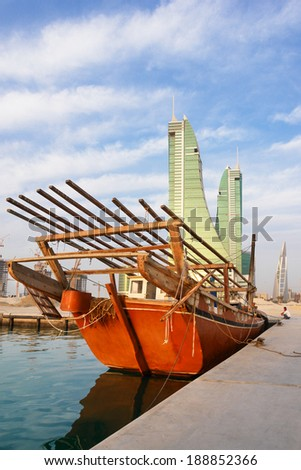 MANAMA, BAHRAIN - FEBRUARY 27, 2009: Manama cityscape with fishermen boat foreground. Bahrain offers visitors a rich history, relaxing beaches and opportunities for fishing and diving.  - stock photo