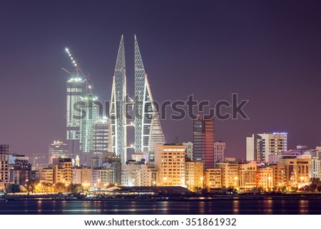MANAMA, BAHRAIN - NOV 17: Manama City skyline illuminated at  night. November 15, 2015 in Manama, Kingdom of Bahrain, Middle East - stock photo