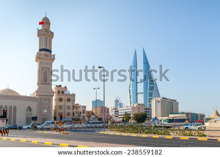 Manama, Bahrain - November 21, 2014: Shaikh Hamad Causeway street view with mosque and The Bahrain World Trade Center. Manama city, Capital of Bahrain Kingdom - stock photo