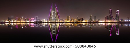 MANAMA , BAHRAIN - OCTOBER 30: Panormic view of Bahrain skyline with iconic buildings, Bahrain Financial Harbour and World Trade center at night, Manama, Bahrain on October 30, 2016