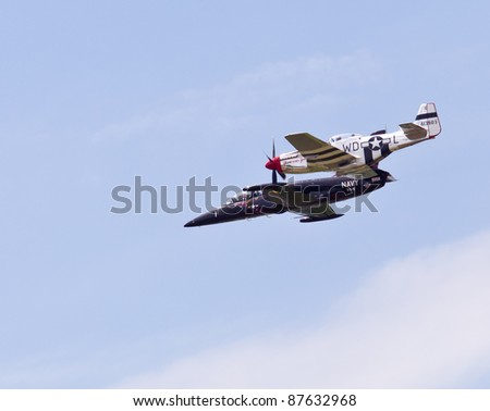 MANASSAS, VA - MAY 6: Albatros L-39 fighter and P-51 Mustang fly at Manassas Air Show on May 6, 2011. This show brings military planes, helicopters and experimental aircraft to Manassas Airport. - stock photo