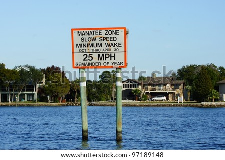 Manatee Zone Slow Speed Minimum Wake Sign - Warning - stock photo