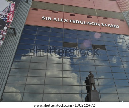 MANCHESTER, ENGLAND - JUNE 2: Statue of Sir Alex Ferguson at Sir Alex Ferguson Stand is home to Manchester United football club team in Manchester on June 2, 2014. - stock photo