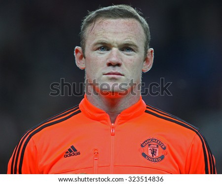 MANCHESTER, ENGLAND - SEPTEMBER 30, 2015: Wayne Rooney looks on prior the Champions League match between Manchester United and Vfl Wolfsburg at Old Trafford Stadium on September 30, 2015 - stock photo