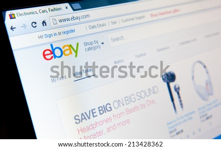 MANCHESTER - FEB 12: eBay home page on Feb. 12, 2014 in Manchester, UK. eBay Inc is an American multinational corporation and e-commerce company, providing consumer-to-consumer sales services via web. - stock photo