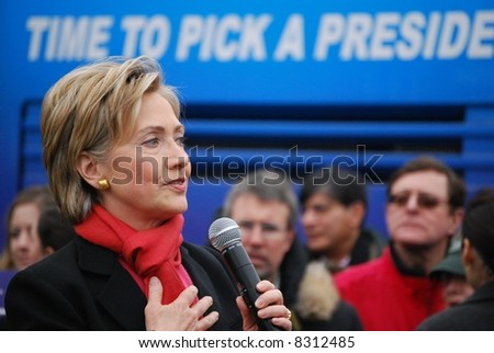 """MANCHESTER, NH – JAN 8: Senator Hillary Clinton  with text """"time to pick a president"""" campaigning to become the Democratic presidential candidate on January 8, 2008, in Manchester, New Hampshire. - stock photo"""