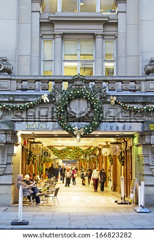 MANCHESTER,UK - DECEMBER 10: Christmas shoppers in the Royal Exchange arcade, December 10, 2013. Manchester's award winning Christmas Markets returns to celebrate its 15th year - stock photo