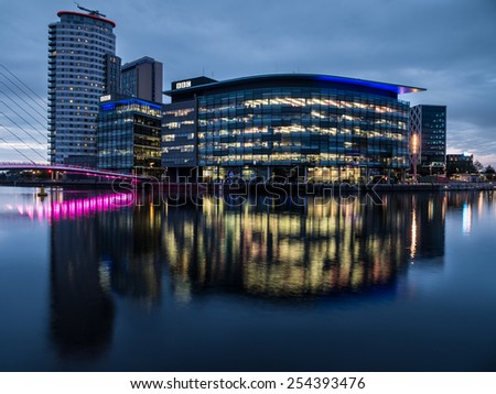 Manchester, UK - June 28, 2014: Twilight view of the BBC TV studios at Salford Quays in Manchester - stock photo