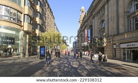 MANCHESTER, UK - NOVEMBER 5, 2014: Shoppers in Queen Anne Square, Manchester which is one of the important pedestrian areas of Manchester - stock photo
