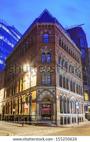 MANCHESTER,UK - SEPTEMBER 2013: The facade of Victorian commercial building, September 20, 2013. Manchester city council unveils ambitious city-wide plans to encourage economic growth through to 2027. - stock photo