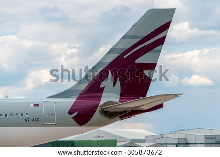 MANCHESTER, UNITED KINGDOM - AUG 07, 2015: Qatar Airways Airbus A330 tail livery at Manchester Airport Aug 07 2015. - stock photo