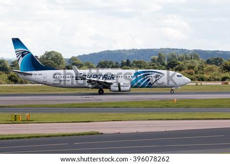 Manchester, United Kingdom - August 27, 2015: EgyptAir Boeing 737 narrow-body passenger plane (SU-GEB) taxiing, Manchester International Airport. - stock photo