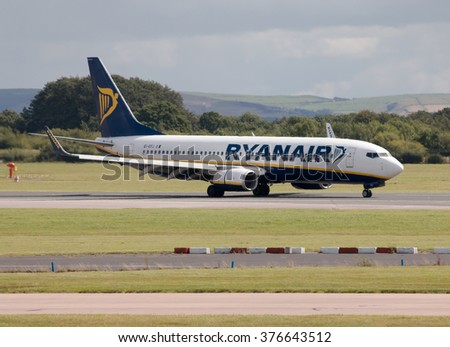Manchester, United Kingdom - August 27, 2015: Ryanair Boeing 737-8AS (EI-EFJ) taxiing on Manchester International Airport after landing. - stock photo