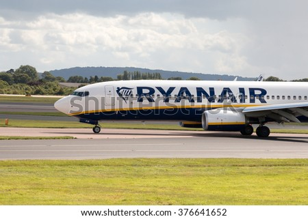 Manchester, United Kingdom - August 27, 2015: Ryanair Boeing 737-8AS (EI-FIR) taxiing on Manchester International Airport after landing. - stock photo