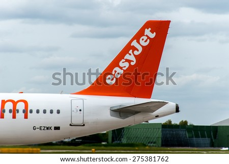 MANCHESTER, UNITED KINGDOM - MAY 04, 2015: Easyjet Airlines Airbus A320 tail livery at Manchester Airport May 04 2015. - stock photo