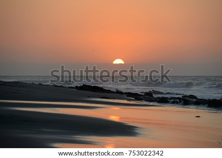 Mancora Beach at sunset with waves and sand