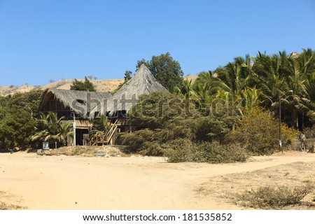 MANCORA, PERU - AUGUST 17, 2013: The hotel La Posada on August 17, 2013 in Mancora, Peru. Mancora is a popular Peruvian beach town where many hotels and hostels await the tourists. - stock photo