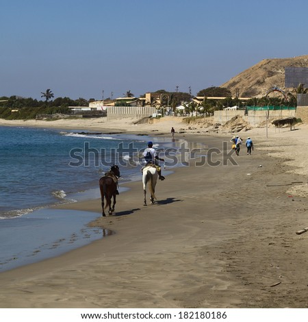 MANCORA, PERU - AUGUST 17, 2013: Unidentified people and horses on the beach on August 17, 2013 in Mancora, Peru. Mancora is one of the most popular beach towns in Peru. - stock photo