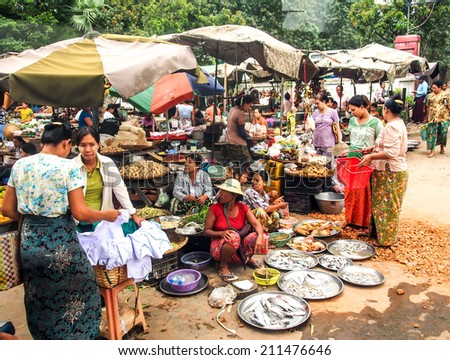 MANDALAY MAY23: A street market in Mandalay selling agricultural products, Mandalay on May 23, 2014. Mandalay is the economic hub of Upper Myanmar and considered as the center of Burmese culture. - stock photo