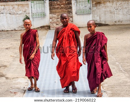 MANDALAY MAY23: Burmese novice boys in Mandalay, Myanmar on May 23, 2014. Myanmar is the most religious Buddhist country in terms of the proportion of monks in the population. - stock photo