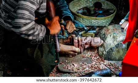 MANDALAY, MYANMAR - DEC 22 : The man making wooden craft Buddha in Mandalay DEC 22 2014 Myanmar. - stock photo