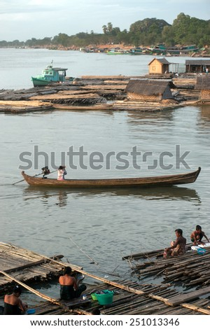 MANDALAY,MYANMAR-JULY 2 : Daily life at bamboo raft on Port activities in Ayeyarwaddy river for sell on July 2,2014 in Mandalay city in Central of Myanmar - stock photo