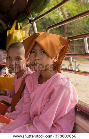 Mandalay, Myanmar March, 12 2016: Buddhist nuns (Lady monks) sitting in the car at Mandalay, Myanmar. - stock photo