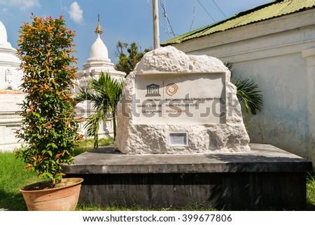 Mandalay, Myanmar - November 18th, 2014: UNESCO memorial inscription for Kuthodaw Pagaoda belonging to the Memory of the World. - stock photo
