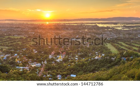 Mandalay with lake mountains, temples and pagodas seen from mandalay hill at sunset, Burma - stock photo