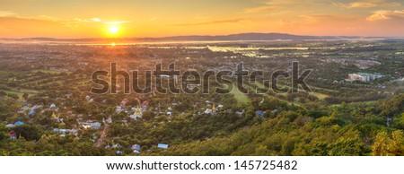 Mandalay with lake mountains, temples and pagodas seen from mandalay hill at sunset, Burma - stock photo