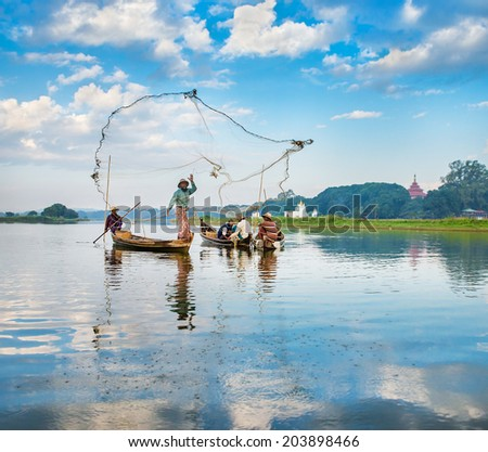 Mandalaymyanmar - December 3: Fishermen catch fish December 3, 2013 in Mandalay. Fishermen show ancient way of fishing nets