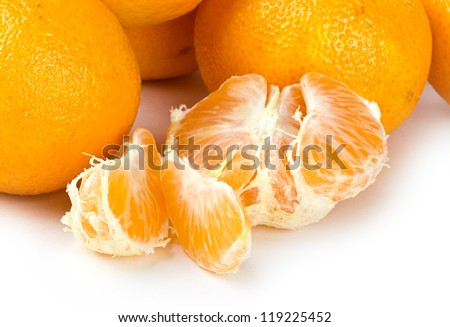 Mandarin fruits with cuts on white background