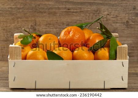 Mandarin orange in wooden box. Selective focus. - stock photo