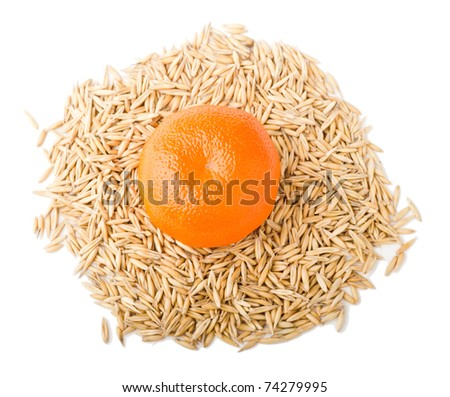 mandarine on cereal  isolated - stock photo