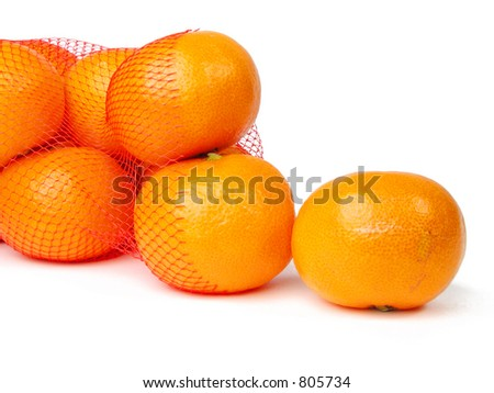 Mandarins getting out from a broken net bag-over white background