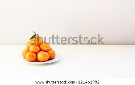 Mandarins on the white table - stock photo
