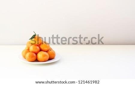 Mandarins on the white table - stock photo