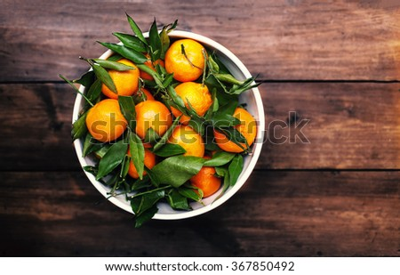 Mandarins Tangerines Closeup. Fresh tangerine clementine on the wooden table, top view - stock photo