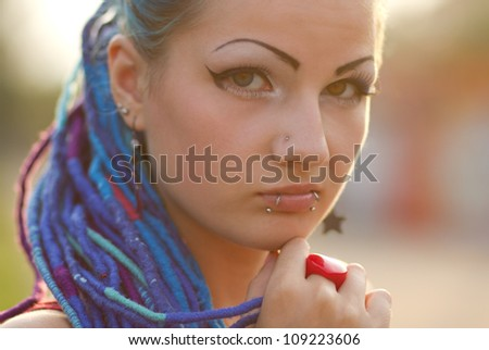 Manga styled young chick posing outdoors - stock photo