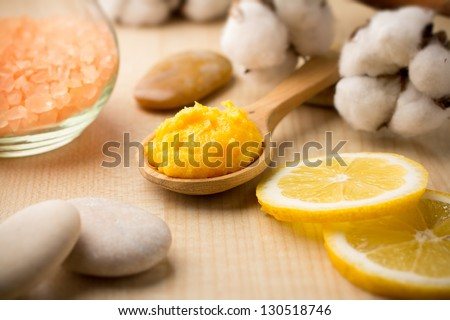 Mango body butter, spa stones and lemon. - stock photo