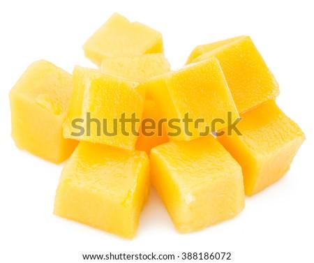 Mango cubes. Isolated on a white background. - stock photo