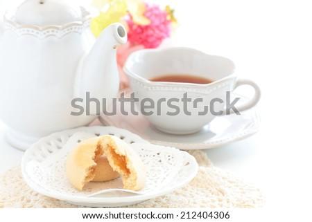 mango filling cookie and English tea - stock photo