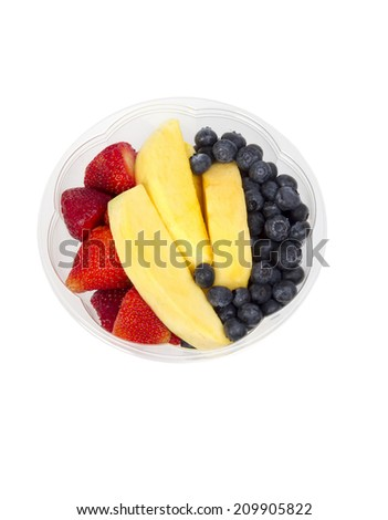 Mango fruit bowl with strawberries and blueberries - stock photo
