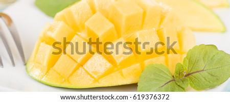 Bangladeshi fruits stock images royalty free images vectors mango hedgehog style cut ripe mango half on a white background ccuart Choice Image