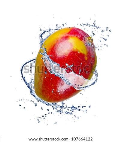 Mango in water splash, isolated on white background - stock photo
