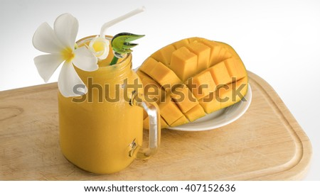 Mango juice, smoothie and mango fruit on a white background - stock photo